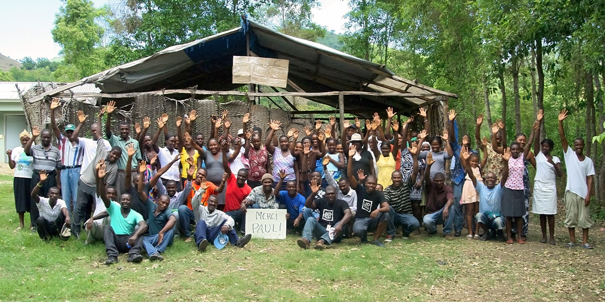 The Cuperlier community gathers in front of their original school house in Haiti