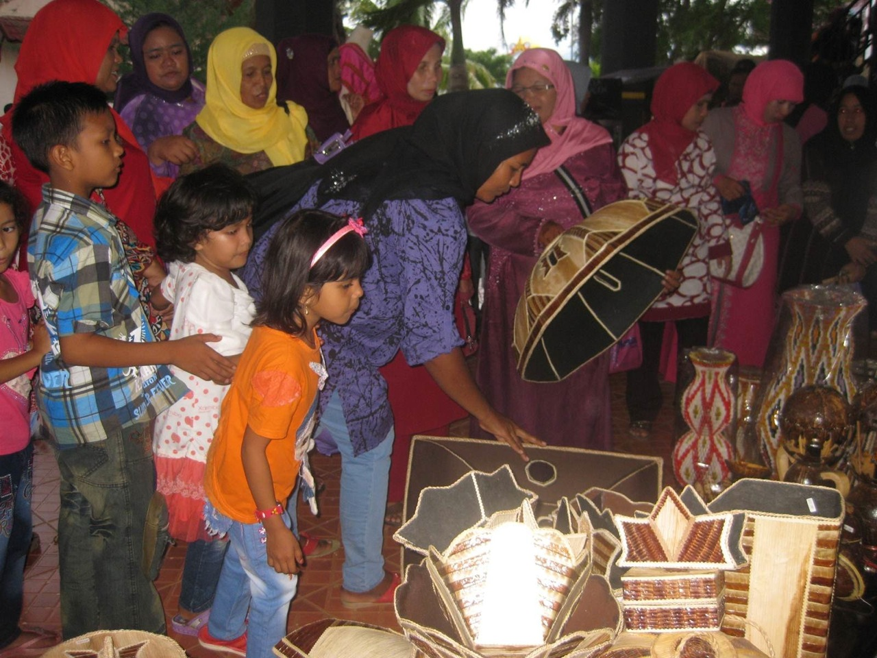 Women showing off their handicrafts at the Ujung Pancu Project