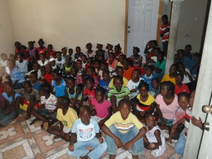 Over 100 children in a program run by ASR trauma relief trainer, Lovely, in Cap Haitian.